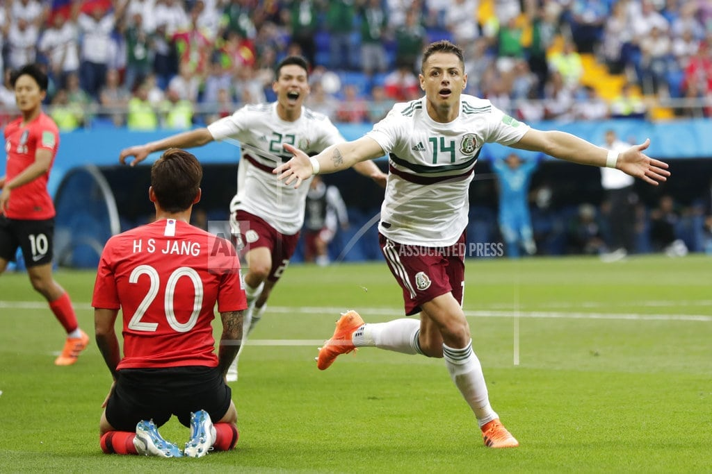 MOSCOW   The Latest: Boetang sent off, Germany down to 10 vs Sweden
