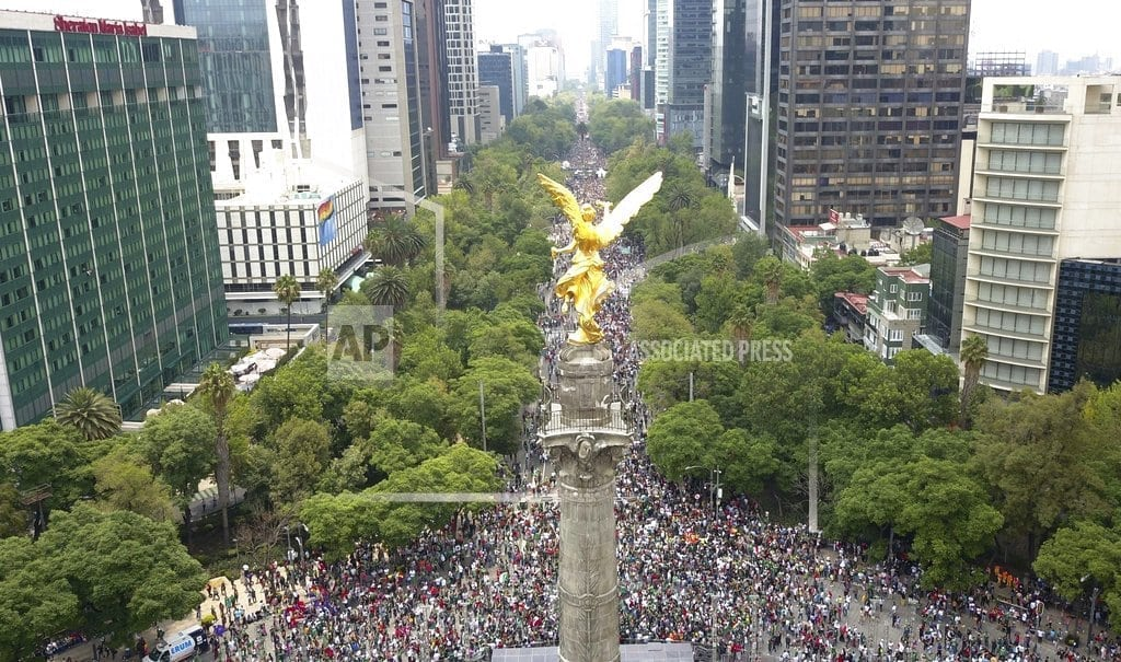 MEXICO CITY   Mexican soccer fans and pride marchers mingle in celebration