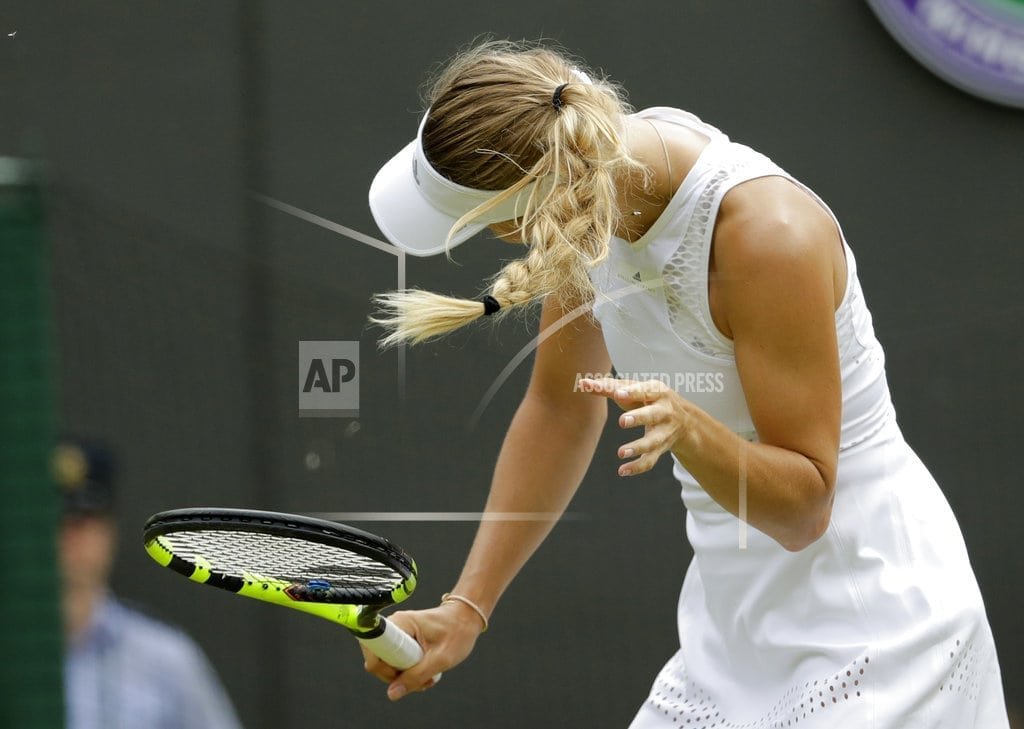 LONDON | Bugs, 'lucky' foe send No. 2 seed Wozniacki out of Wimbledon