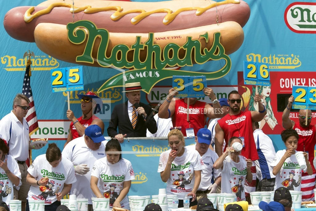 NEW YORK | Defending champ Chestnut sets record with 74 hot dogs