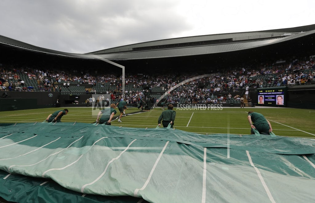 LONDON | The Latest: Play halted by rain at Wimbledon