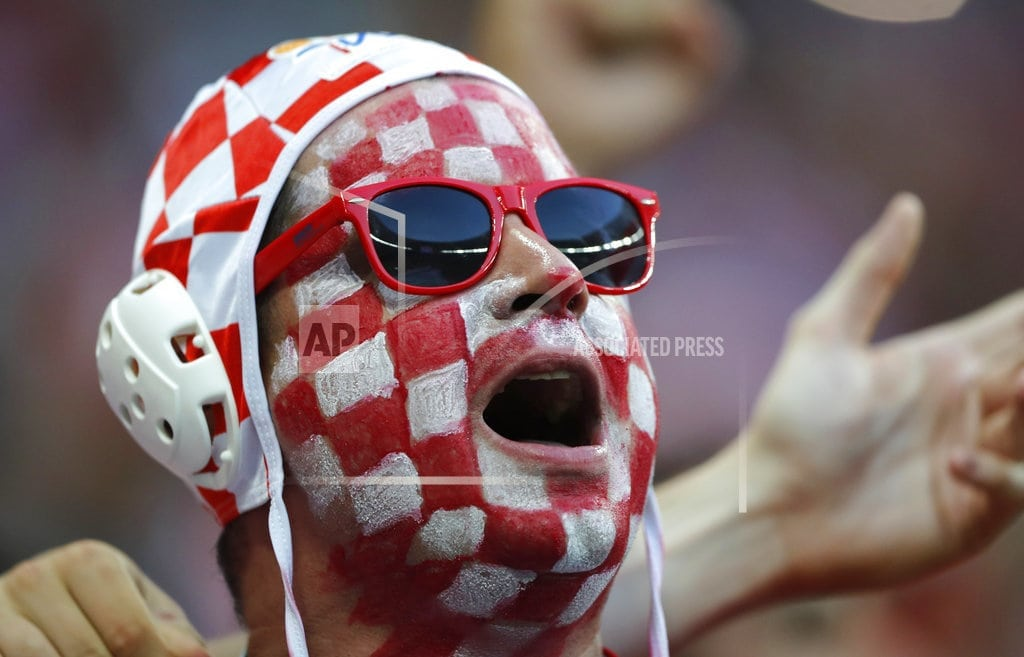 MOSCOW | The Latest: Wimbledon fans tuning in to World Cup semifinal
