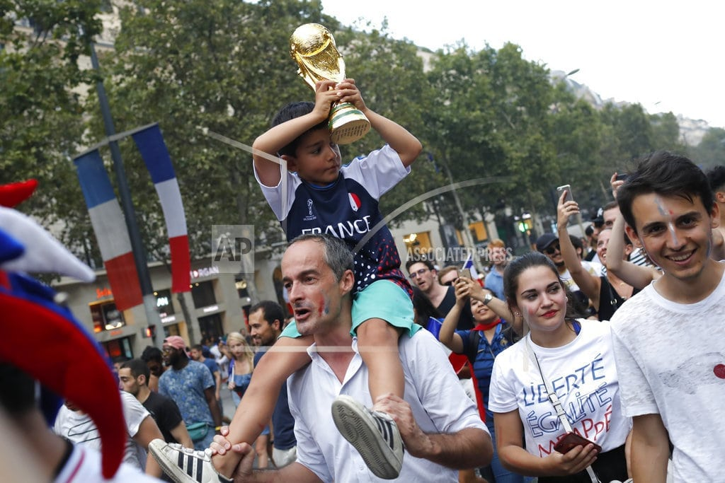 PARIS | With flags, song, pride, French celebrate unifying victory
