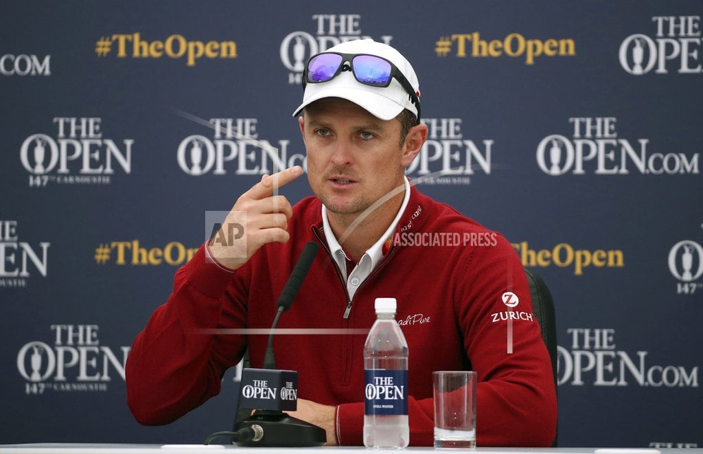 CARNOUSTIE, Scotland | The Latest: Thomas hopeful holding claret jug won't jinx him