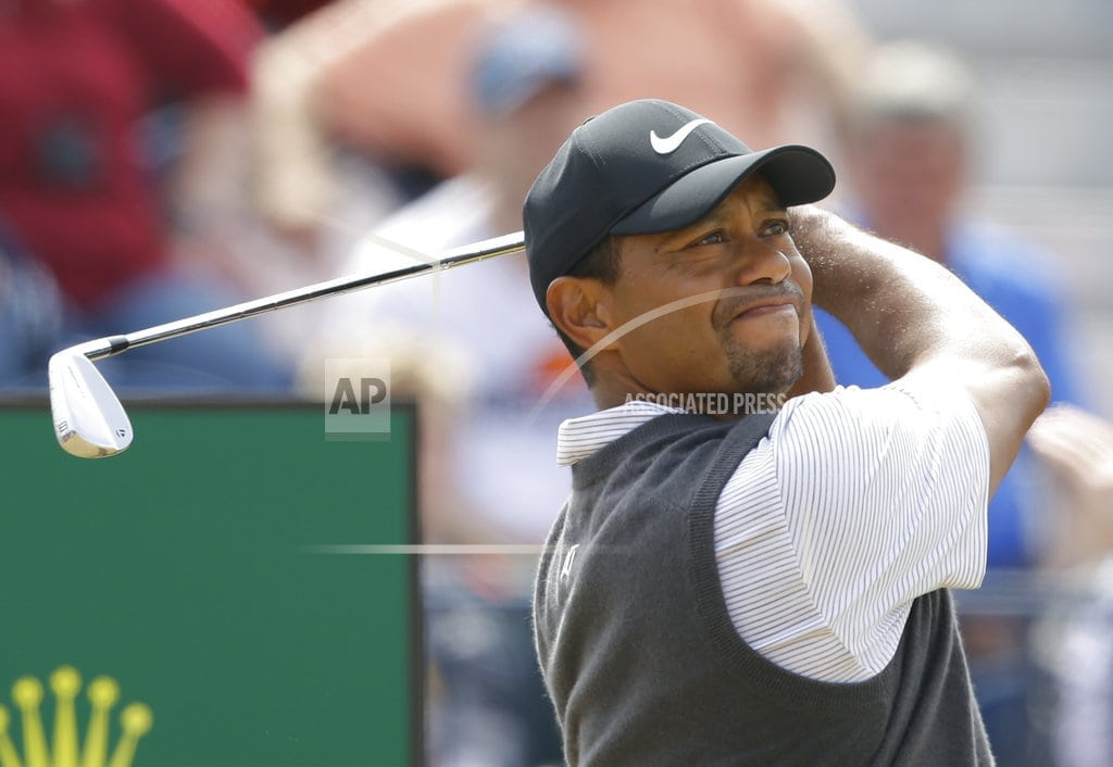CARNOUSTIE, Scotland | The Latest: Woods top of leaderboard at British Open