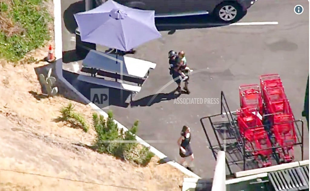 LOS ANGELES | The Latest: Man who took hostages at supermarket in custody