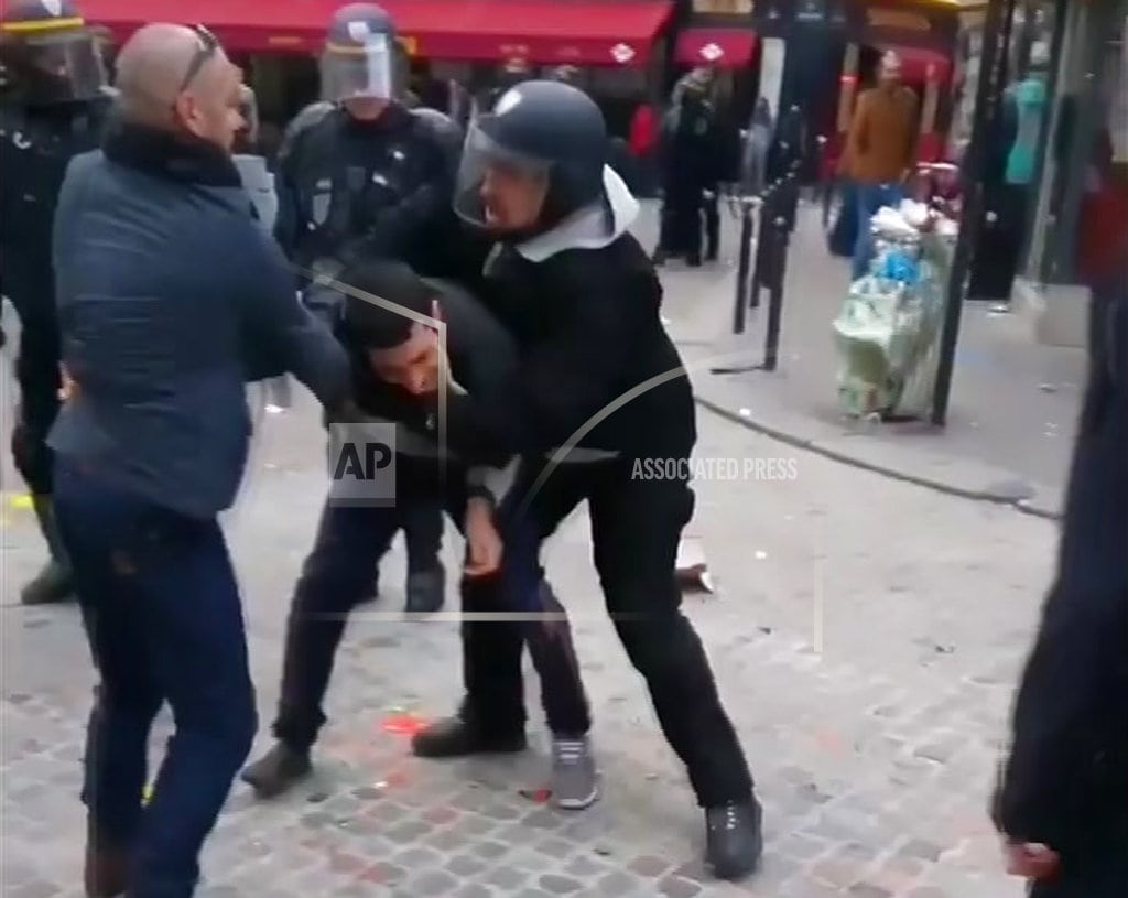 PARIS |Macron's security aide detained, was filmed beating activist