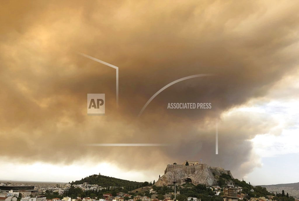 ATHENS, Greece | Residents flee forest fire near Greek capital of Athens