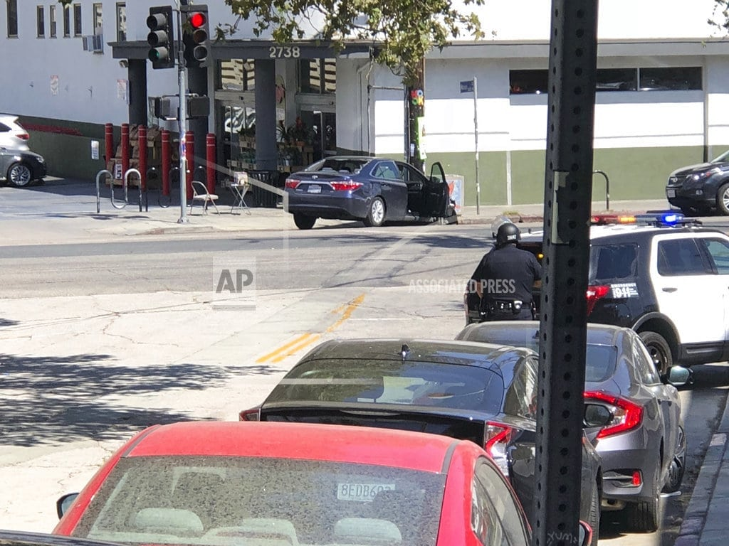 LOS ANGELES | The Latest: Authorities say 1 killed in LA market standoff
