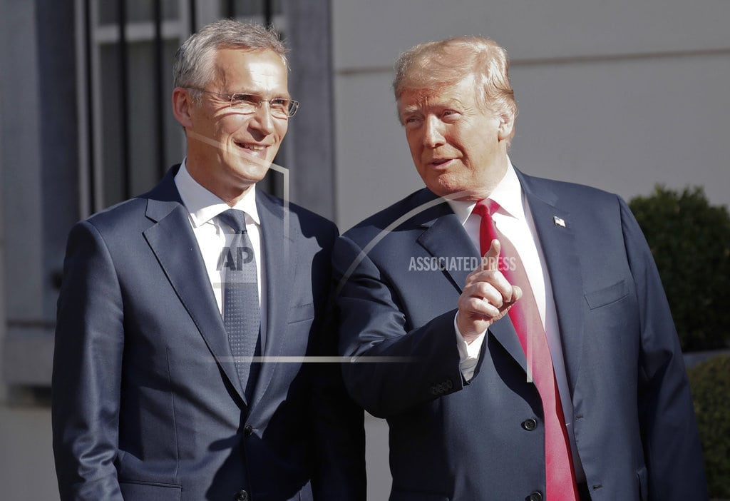 BRUSSELS | The Latest: Trump to watch military parade at Windsor Castle