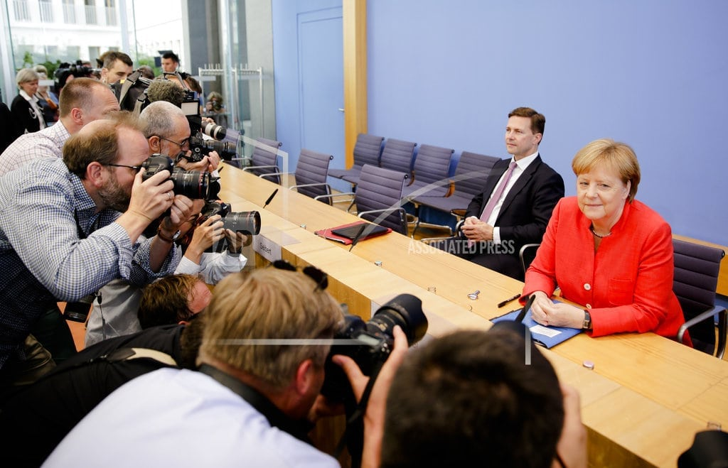MOSCOW | The Latest: Merkel: US and Russian meetings should be normal