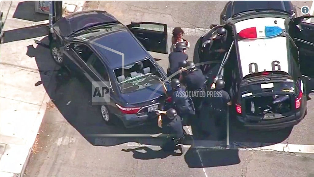 LOS ANGELES | Shooting suspect in standoff at LA market; 1 woman killed