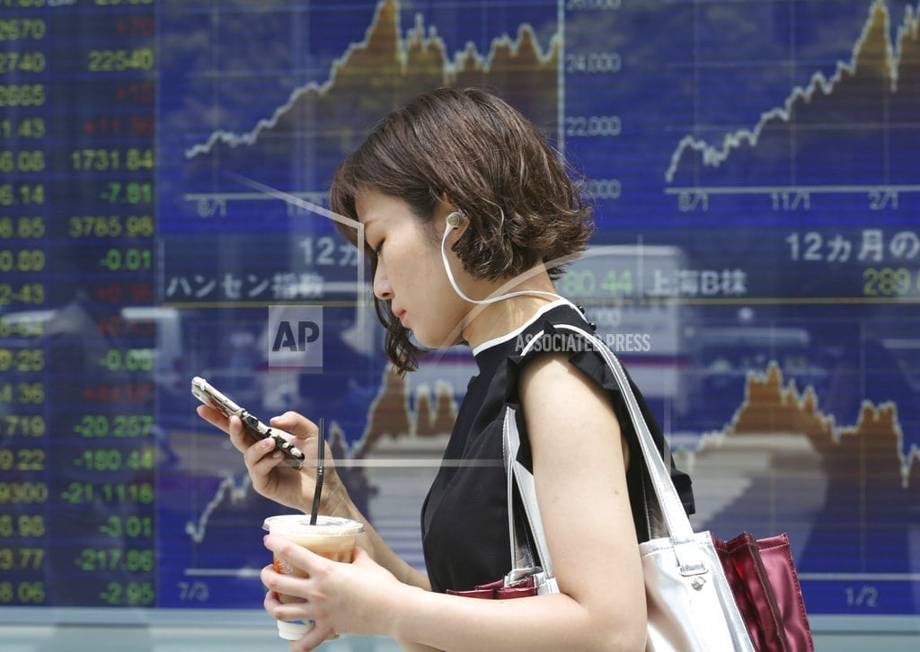 SINGAPORE | Asian shares mostly lower, weighed by trade tensions