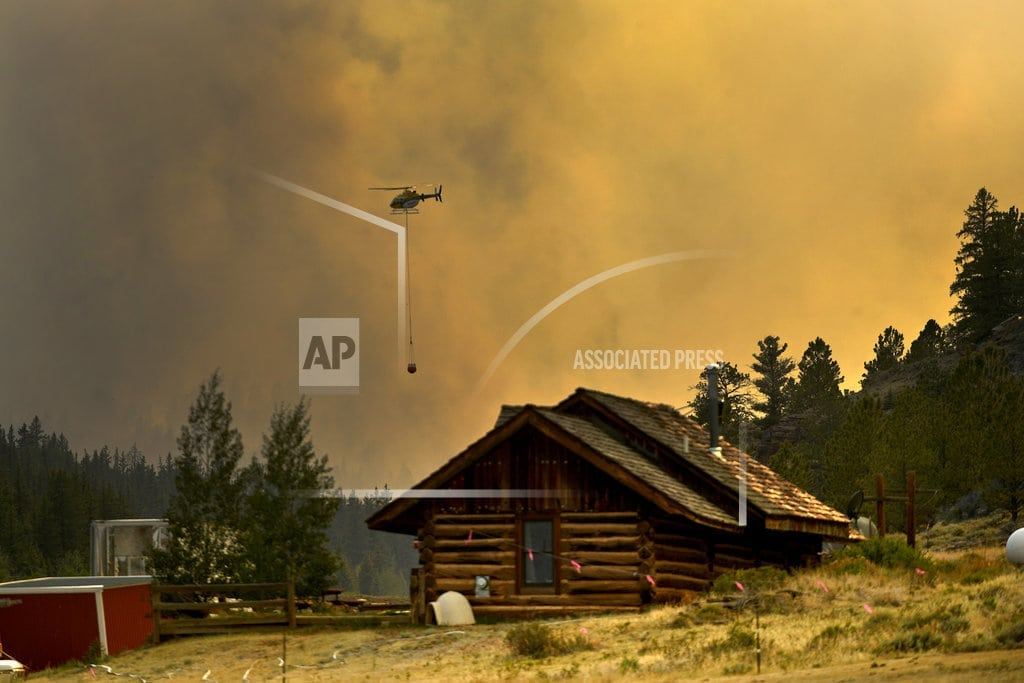 DENVER | Exploding wildfires in US West derail holiday plans