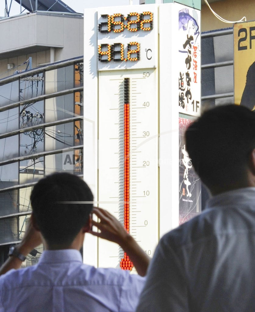 TOKYO  | The Latest: Japan records its highest temperature ever