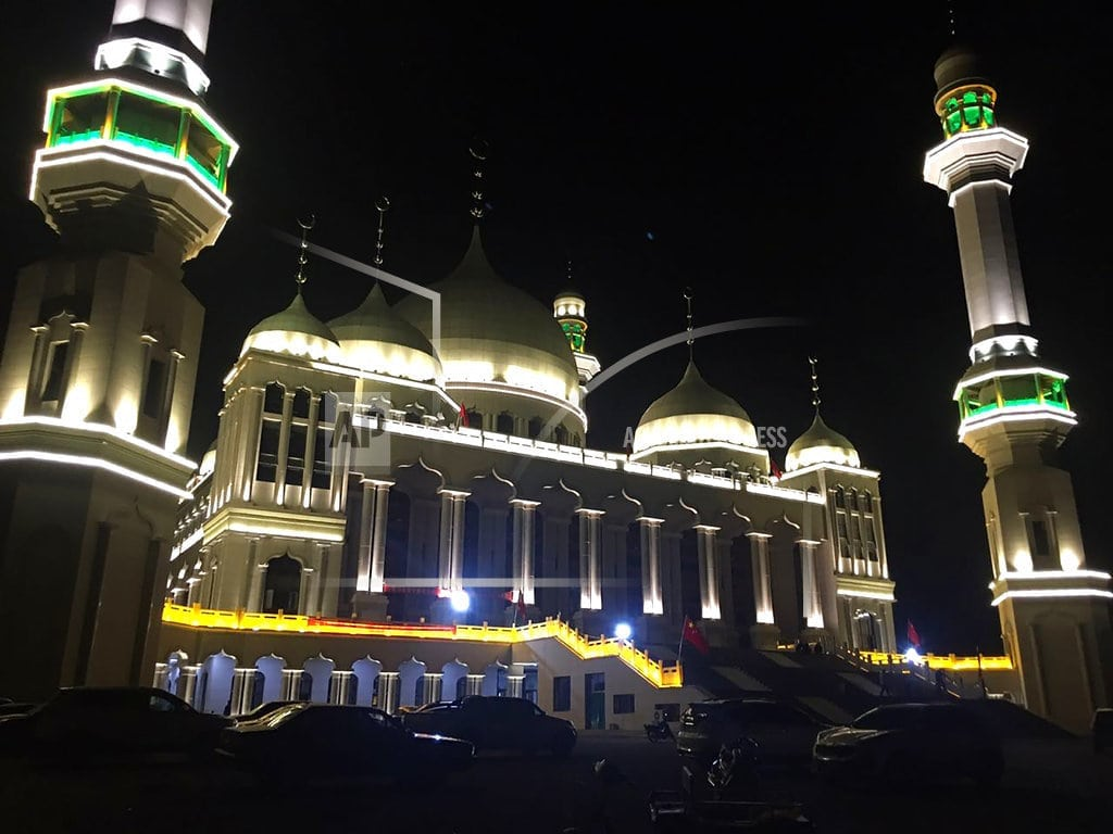 WEIZHOU, China   Religion must obey Chinese law, paper says of mosque protest