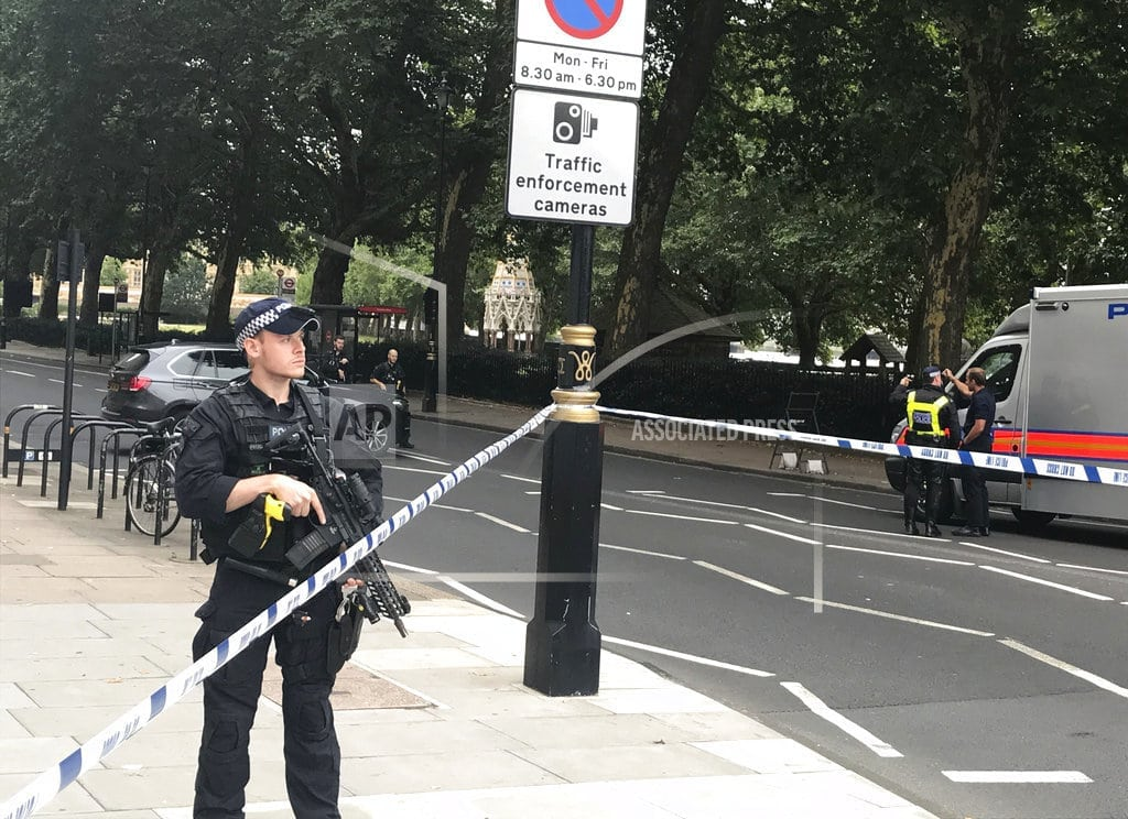 LONDON | The Latest: UK police say properties raided after car crash