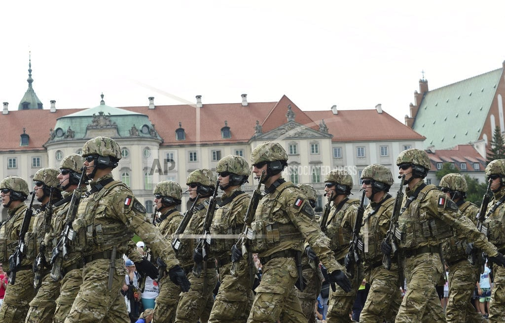 WARSAW, Poland | Poland marks Army Day with parade, call for US military base