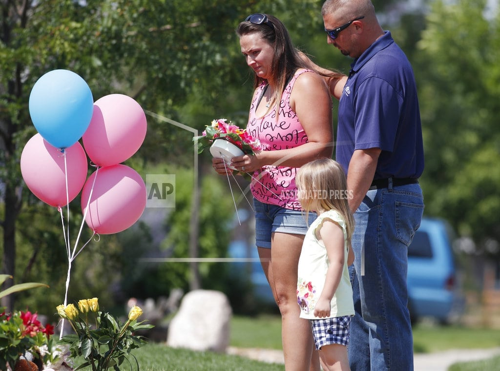 FREDERICK, Colo. | The Latest: Lawyer says girls' bodies were submerged in oil