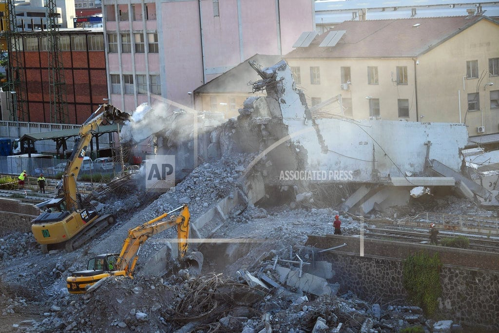 GENOA, Italy | Large pieces of rubble removed 3 days after bridge collapse