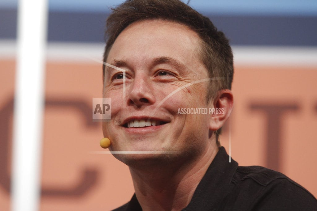 NEW YORK | The Latest: Tesla shares fall as Musk says stress takes toll