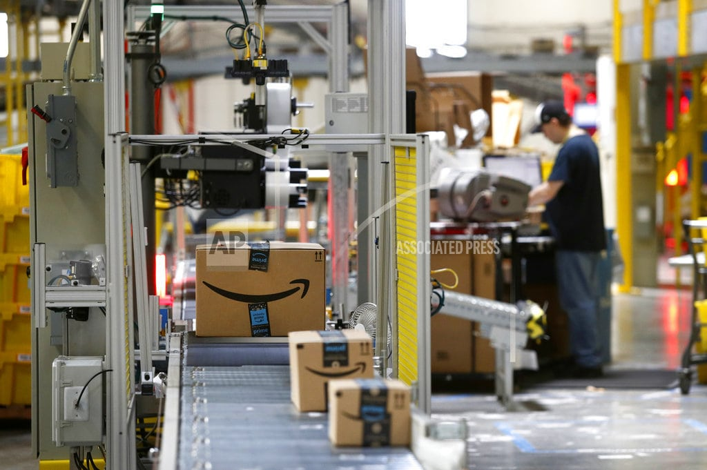 NEW YORK | 'We are totally happy,' says paid Amazon workers on Twitter