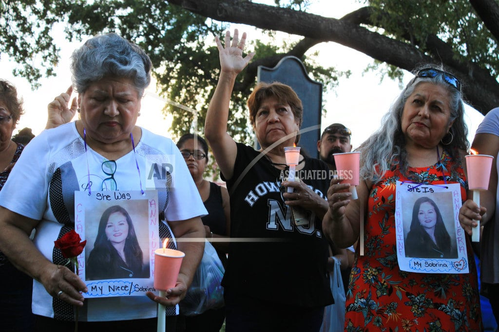 LAREDO, Texas   Relatives have vigil for 4 allegedly killed by border agent