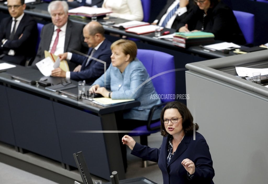 BERLIN | German government seeks to end standoff over spy chief