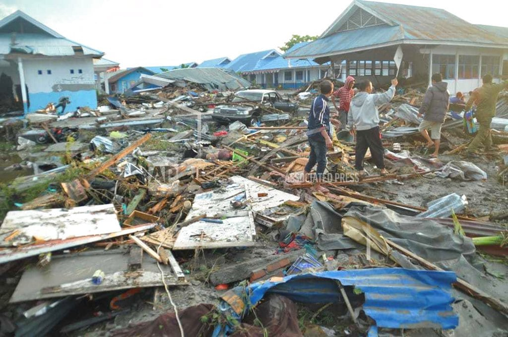PALU, Indonesia | The Latest: Many feared buried in residential complex debris
