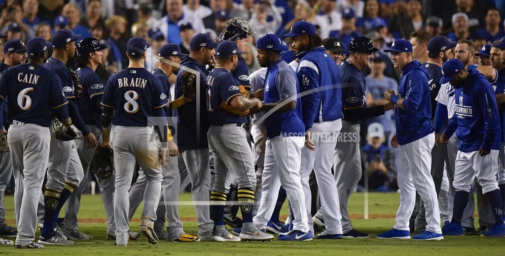 LOS ANGELES | Benches clear after Machado clips Aguilar's leg in NLCS