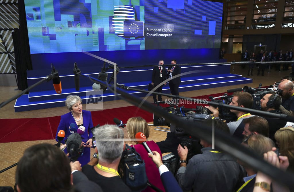 BRUSSELS | May says Brexit transition era could grow, angers many in UK