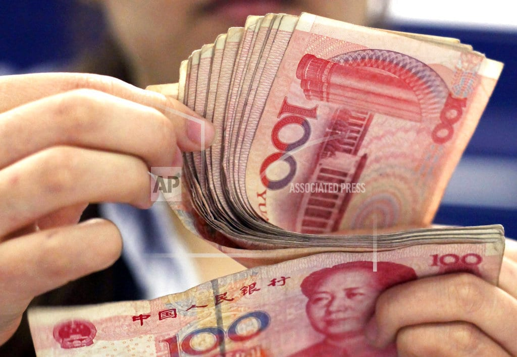 BEIJING | China's yuan sinks further after US currency report