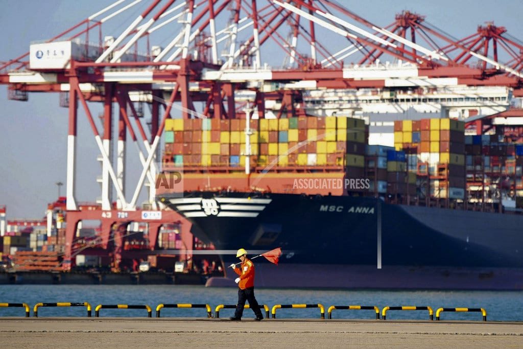 BEIJING  | China's growth slows as officials try to reassure investors
