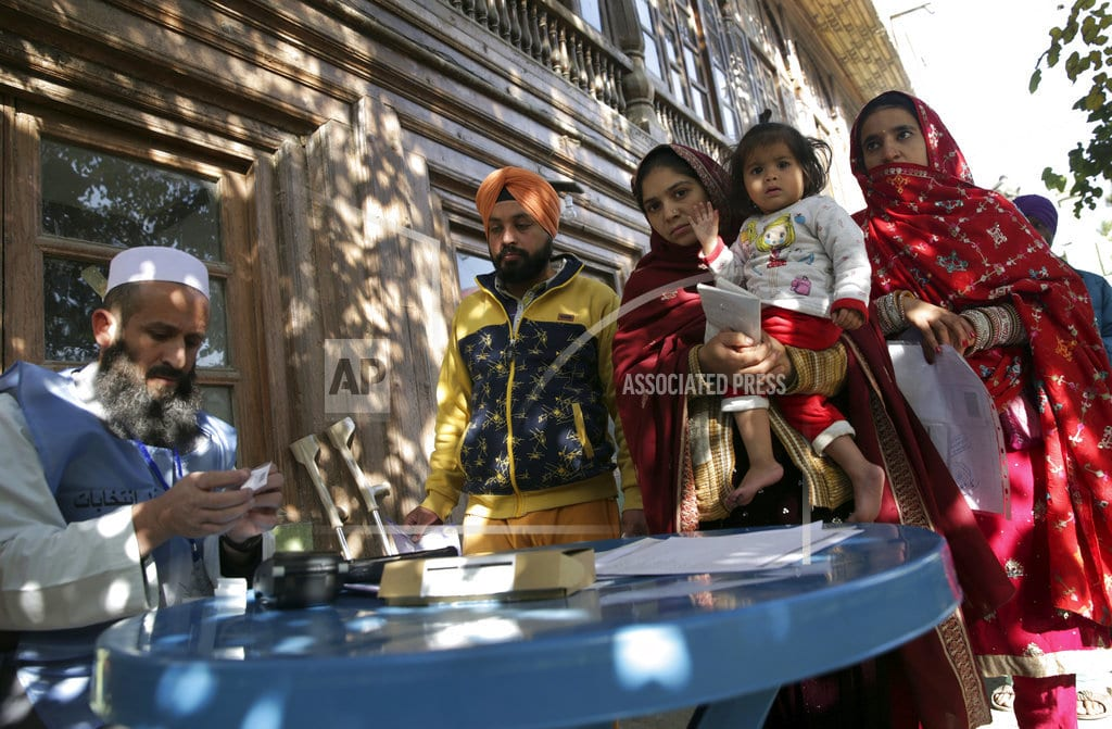 KABUL, Afghanistan | The Latest: Afghan official outraged by polls' chaotic start