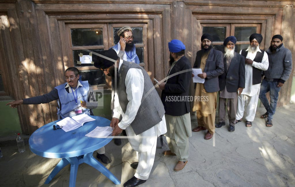 KABUL, Afghanistan | The Latest: Afghan officials say IED at poll wounds 4