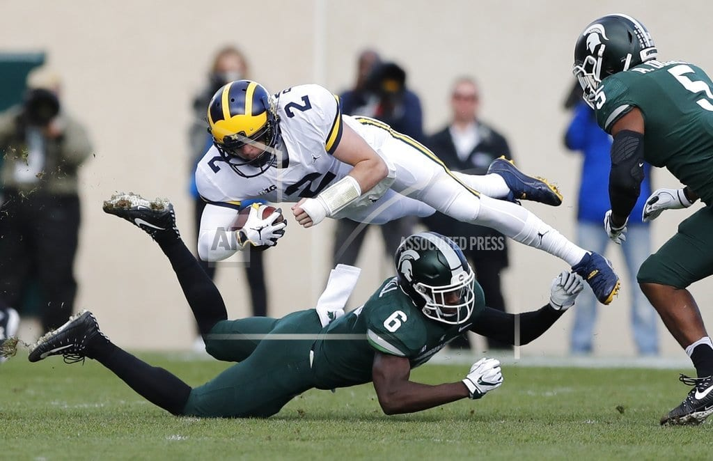EAST LANSING, Mich. | Patterson-led No. 6 Michigan tops No. 24 Michigan State 21-7