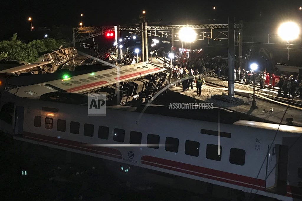 DONGSHAN TOWNSHIP, Taiwan | Rescuers search site after train crash killed 18 in Taiwan