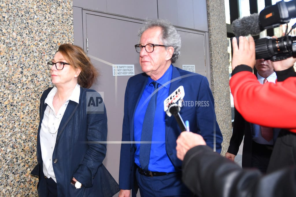 SYDNEY   Geoffrey Rush says he was 'distraught' over paper's articles