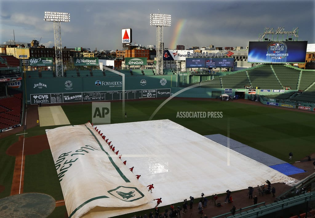 BOSTON  | The Latest: Fans advised to take cover at Fenway before game