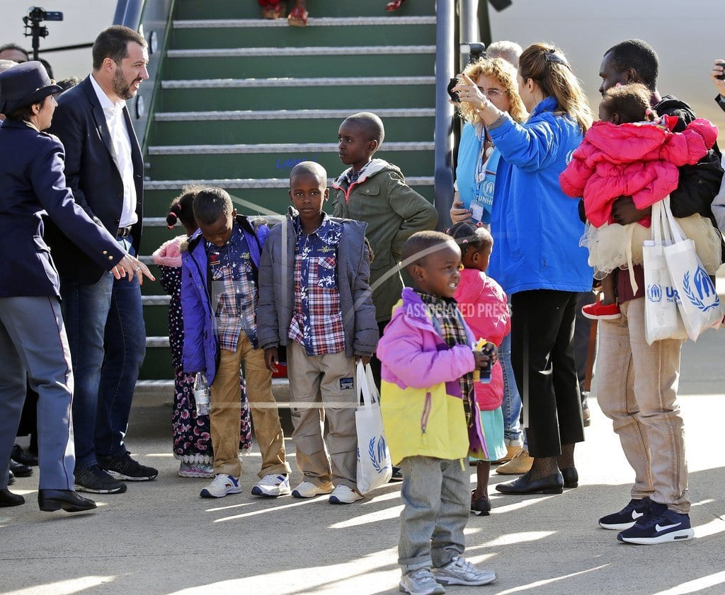 BRUSSELS | The Latest: Italy's anti-migrant minister greets refugees