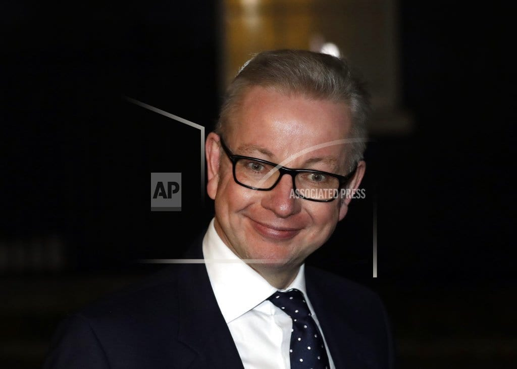 LONDON | The Latest: Environment Minister Gove won't quit over Brexit