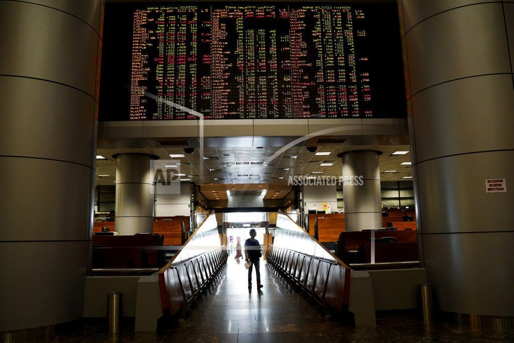 BEIJING | Stocks mostly rise but Europe weighed down by Brexit discord
