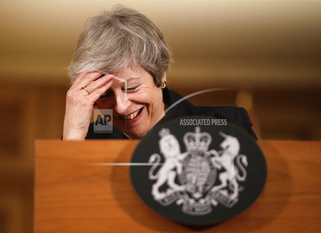LONDON | The Latest: UK's May fills Brexit-related Cabinet vacancies