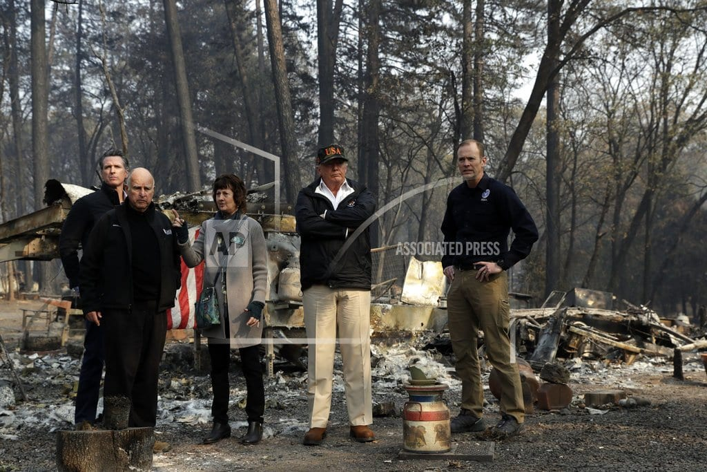 PARADISE, Calif | Trump sees wildfire areas, consoles those harmed by shooting