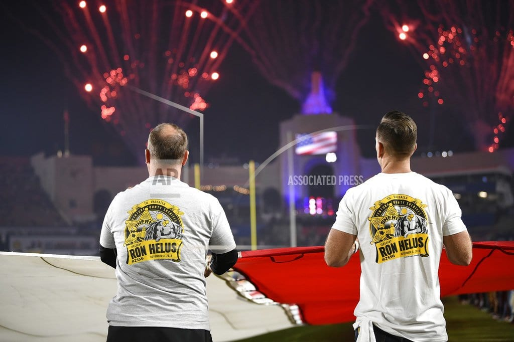 LOS ANGELES  | Rams honor firefighters, police for recent heroic actions