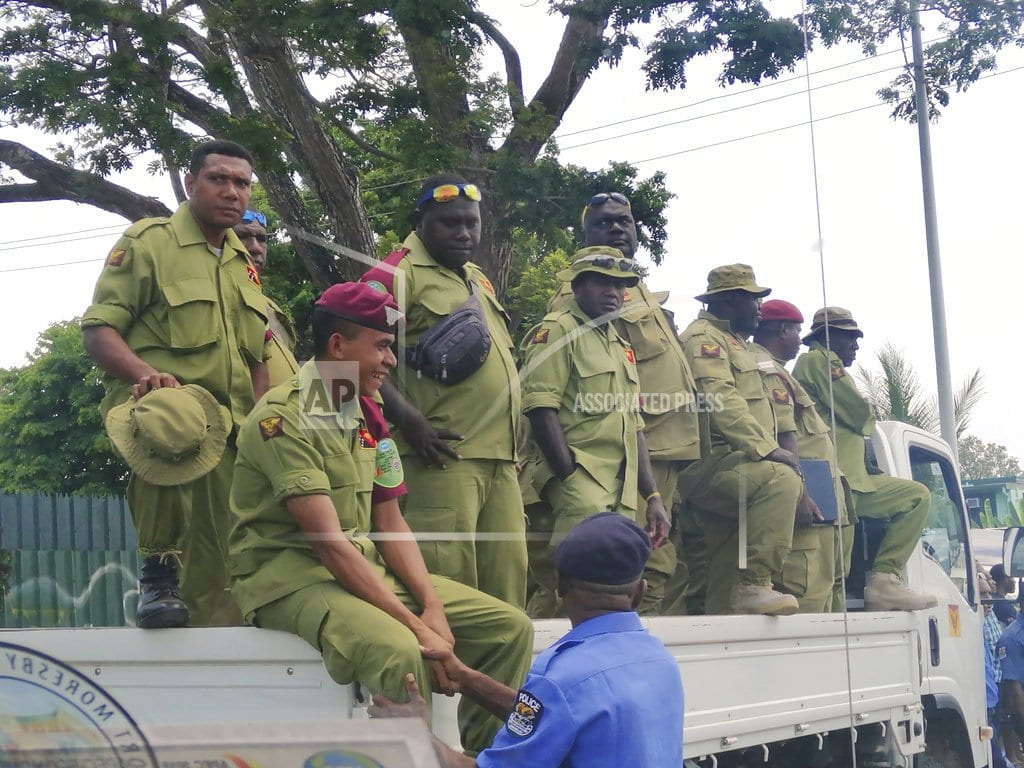 PORT MORESBY, Papua New Guinea | Police storm Papua New Guinea Parliament for APEC summit pay