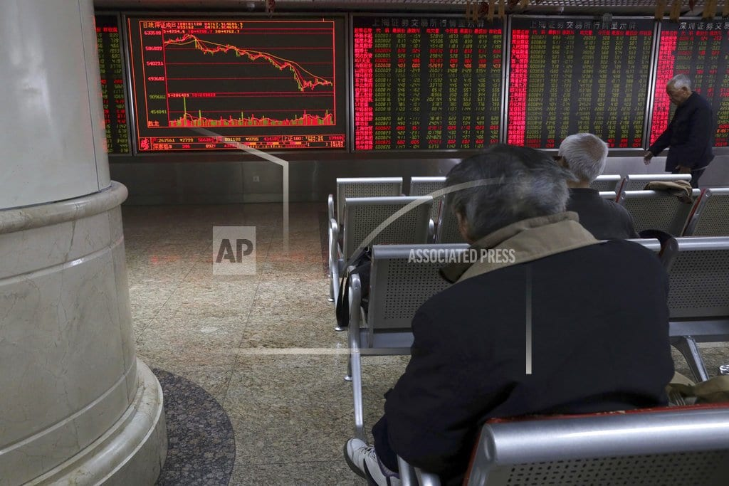 BEIJING | Global stocks slide as futures point to Wall Street drop