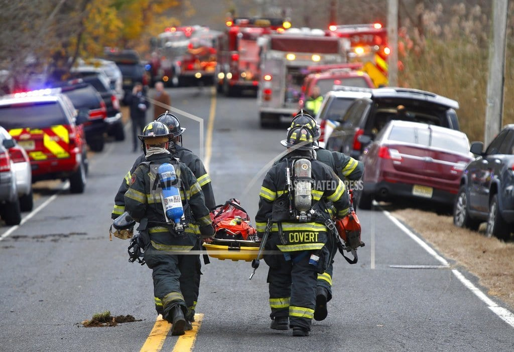 COLTS NECK, N.J   Authorities probe mansion fire where 4 found dead