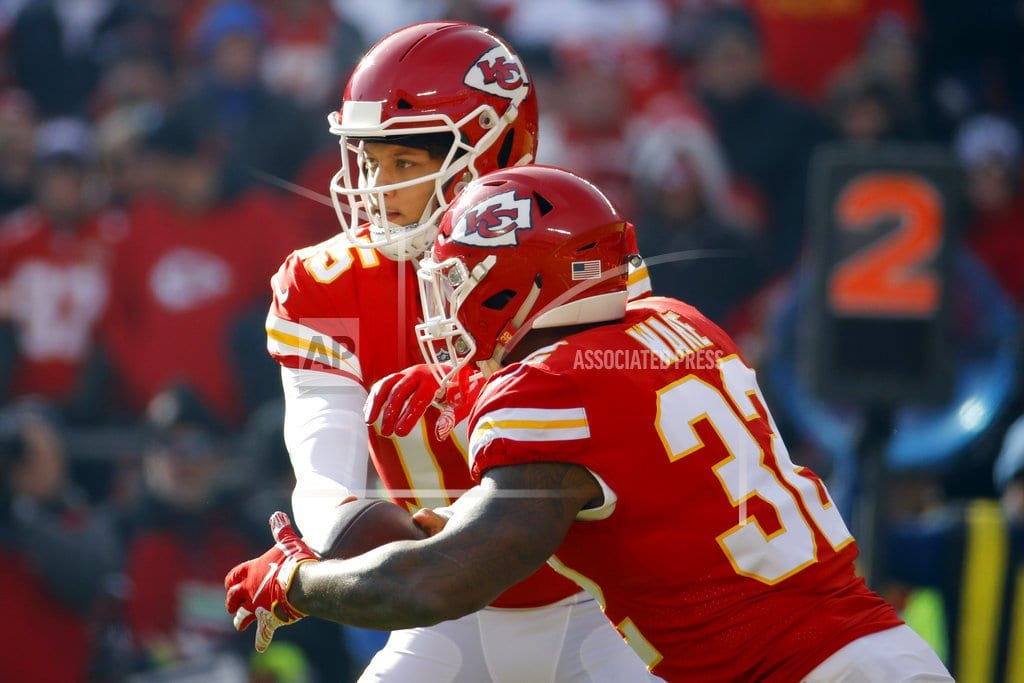 The Latest: Chiefs lose Ware, Hill to 2nd-quarter injuries
