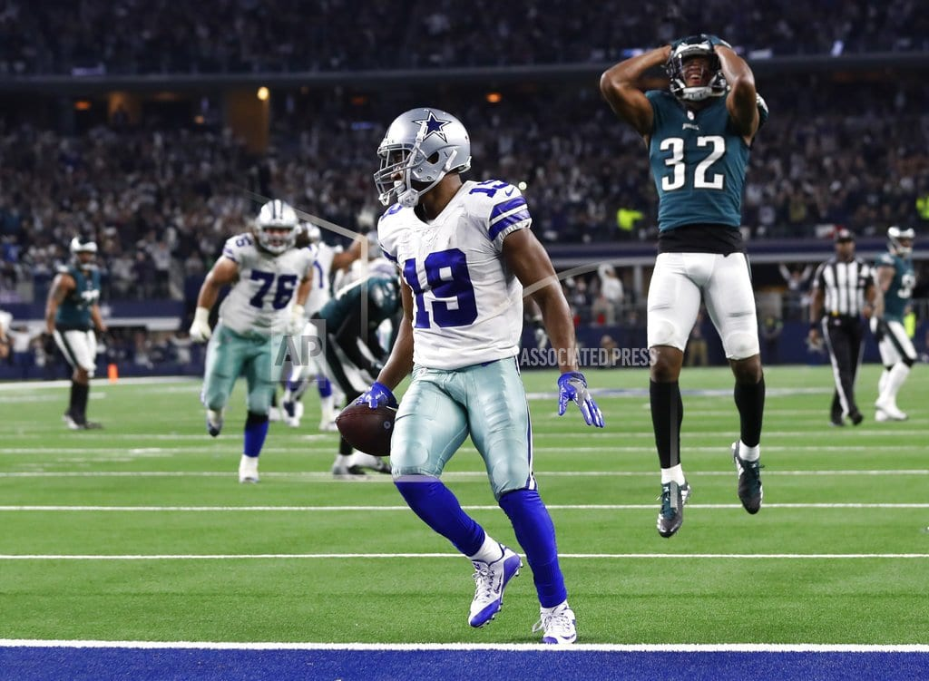 The Latest: Cowboys stretch East lead with OT win vs. Eagles